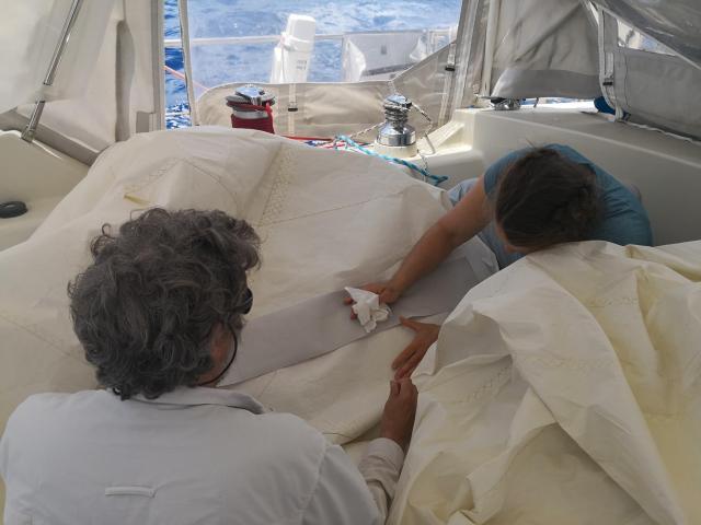 Kate repairing sail 2