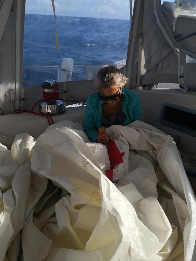 Kerstin repairing sail